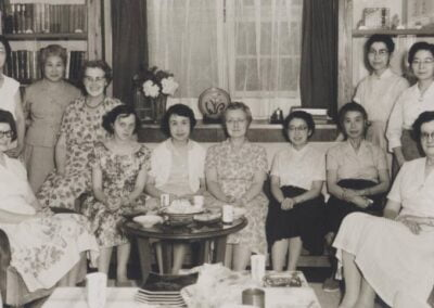 Deaconess Daphne Rogers (left end of couch) was on the teaching staff of Toyo Eiwa school for girls in Japan. She served in Japan from 1959 until her retirement in 1994.