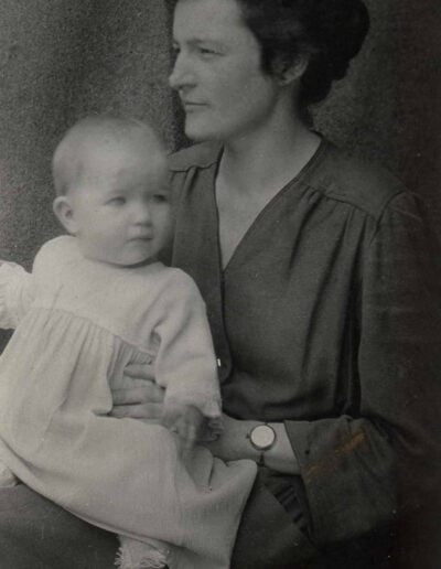 After Vera Clark's missionary husband died in 1925 she left China to enter the United Church Training School. Her work as a Deaconess was in congregational education until she remarried and was disjoined in 1945. Here with daughter in China in 1921.