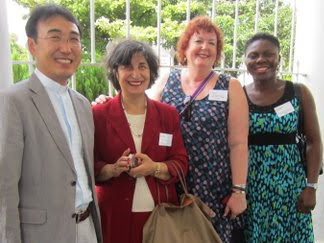 Barb Lloyd (blue dress) with Korean, Lebanese and Nigerian participants in WCC Diaconal Conference in 2012.